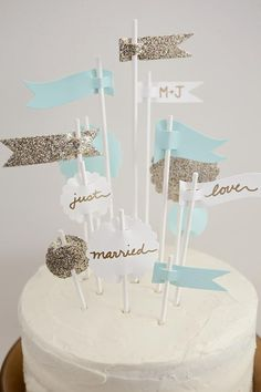 DIY Weddings: Cake Topper Ideas and Projects. Party flags are a simple way to make a big impact. >> http://www.diynetwork.com/decorating/diy-weddings-cake-topper-ideas-and-projects/pictures/index.html?soc=pinterest