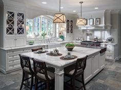 white kitchen island design island seating island leg post design white marble countertops butcher block island wall cabinet design grey tile floors