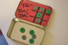 Tic- tac- toe kit. Used ribbon for lines, tins from the dollar tree that held small puzzles, and used glitter flower stickers attached to circles cut from fridge advertising magnet squares. Also included a counting cows, scavenger hunt and I spy game printed from momsminivan.com. In a second tin I included cat's cradle instructions, Jacobs ladder instructions and string.