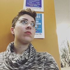 First counselling services appointment today. Wish me luck! #therapyselfie #hospitalglam [selfie of a person with short brown hair and a grey cowl-neck dress sitting in a waiting room with yellow walls]