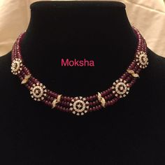Simple 3 line ruby beaded strings with diamond clasps look beautiful and elegant. This diamond ruby party wear necklace is an exclusive piece Ruby Jewelry, India Jewelry, Bridal Jewelry, Diamond Jewelry, Diamond Necklaces, Gold Jewellery Design, Bead Jewellery, Beaded Jewelry, Jewelry Necklaces