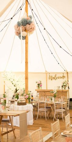 Our Petal pole marquee beautifully dressed for a country wedding reception. We supplied bare reclaimed-wood tables and limewash chiavari chairs to give it a warm rustic feel.
