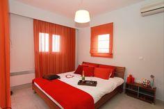 Lovely red bedroom  http://www.villastostay.com/villa.php?region=Rhodes