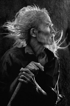 by Nguyen Dinh Quoc Van. Old man, male, guy, oldie, beard, hands, fingers, stick, profile, portrait, wrinckles, a face that have stories to tell, beauty, face, powerful, intense, photograph, photo b/w.