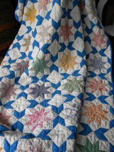 This was an antique quilt found at an estate sale, tattered on the edges and dirty. A new binding and a good washing and the quilt is beautiful! Click on the link for a close up of the very fine quilting. <3