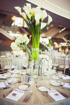 Dramatic, modern centerpieces filled with fresh white calla lilies. Photo by Amelia Lyon, Flowers by Floral Elements