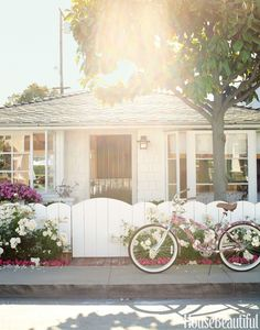 In front of the 1938 California cottage is a Liberty of London bicycle from Target; it belongs to designer Krista Ewart's sister Laurie Thiel, the home­owner. - HouseBeautiful.com