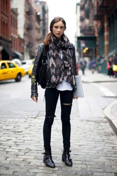 New York — Pilar Solchaga's ripped jeans are J Brand and her boots are Office — they're also the perfect pairs for navigating NYC's cobblestone streets.