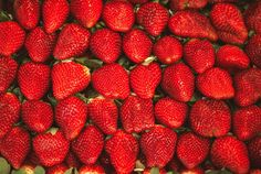macro photo of a lot of strawberries in full frame