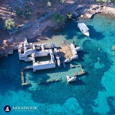 Cleopatra's Hamam Koyu Göcek Islands region Turkey . High above the sunken ruins of the old Turkish bath house reputed to have been built for Cleopatra.  The gorgeous turquoise water and proximity to Göcek and Fethiye makes this a popular anchorage for Blue Cruises and daily boat trips. . . . #cleopatrashamam #gocekislands #gocek #fethiye #mugla #turkey #ruins #dronephotography #turquoise #travel #travelphotography #beautifuldestinations #bluecruise  #gulet