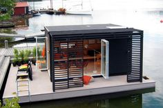 Modern Kenjo Cabin is a solar-powered floating room for a family in Sweden
