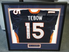 Custom framed Tim Tebow jersey with engraved name plate.
