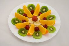 Assorted fresh fruit - orange cherry kiwi