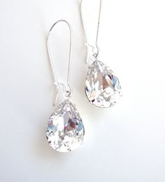 Hey, I found this really awesome Etsy listing at https://www.etsy.com/listing/87853543/pear-clear-swarovski-crystal-earrings
