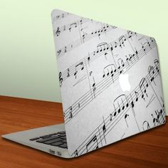 Macbook Air or Macbook Pro (13 inch) Vinyl, Removable Skin - Music Notes on a Page by Victory, http://www.amazon.com/dp/B0098OSKWY/ref=cm_sw_r_pi_dp_Gkq7qb101YBEN
