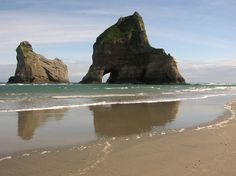 Rugged meets refined on Wharariki Beach in New Zealand.