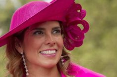 Royal Ascot race hats ( Alastair Grant / Associated Press / June 20, 2012 ) Rosa Aiello poses in a hot pink hat.