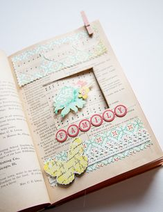 make a window cutout in a vintage book.