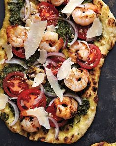 Shrimp and Pesto Pizza Recipe. In a departure from the standard pizza toppings, grilled dough is spread with basil pesto and scattered with shrimp, sliced tomatoes, and shaved Parmesan. Pesto Pizza, Naan Pizza, Pizza Pizza, Pizza Food, Pizza Dough, Naan Flatbread, Crust Pizza, Pizza Recipes, Seafood Recipes