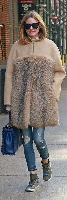 Who made  Olivia Palermo's blue handbag, brown coat, ripped skinny jeans, key chain, and sneakers?
