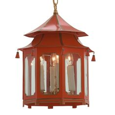 Bring some chinoiserie into your space with this charming red and gold pagoda lantern. Measures 18