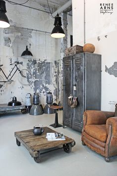Quintessential mix of industrial and antique - vintage leather club chair next to industrial metal lockers