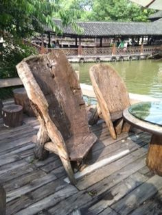 Rustic Chair hewned from a log from an ancient village in China.