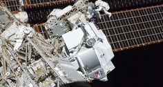 COSMIC RAY COLLECTOR The Alpha Magnetic Spectrometer (center) analyzes speedy cosmic particles from its perch on the International Space Station. New results may complicate scientists' understanding of where the particles come from. ~~ NASA