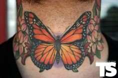 Monarch butterfly throat tattoo by Fish