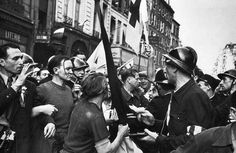 Robert Capa, Members of the French Resistance during the liberation of the city, France, Paris. August 25th, 1944
