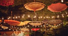 I love the idea of these hanging umbrellas for a party on the patio.