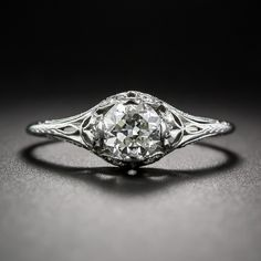 .70 Carat GIA: H VS2 Edwardian Diamond Engagement Ring I'd be happy with this.