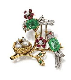 COLORED STONE AND DIAMOND BIRD BROOCH, VAN CLEEF & ARPELS, CIRCA 1945. Designed as two songbirds perched on a gold branch bearing ruby and diamond florets, their bodies centering emerald-cut emeralds, further set with small round, single-cut and baguette diamonds, one peering into a nest with two baby birds composed of cultured pearls with diamond heads, mounted in 18 karat gold and platinum, signed VCA, numbered 28527.