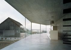 A crooked concrete wall divides this Zurich building into semi-detached homes.