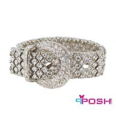 """Product # PO-B5427    Product Category POSH Bracelets / Bangles    - Stretch bracelet  - Silver tone metal with white crystals  - Belt buckle design in centre  - Stretch bracelet will fit most sizes  - Dimension: 0.79"""" band width, Belt buckle width: 1.38""""    POSH by FERI - Passion for Fashion - Luxury fashion jewelry for the designer in you.    In order to prolong the lifespan of your POSH Jewelry, when not in use, we recommend you store your pieces in Anti-Tarnish bags…"""