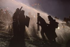 NEAR CANNON BALL, N.D. 11/20/2016 In freezing weather, police officers used a water cannon on people protesting plans to pass an oil pipeline near the Standing Rock Indian Reservation. Stephanie Keith/Reuters