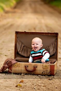Laughing baby boy in old suitcase on dirt road #outdoor_childrens_photography #outdoor_photography_children