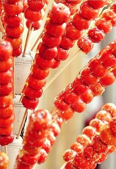 "Beijing Specialty - Tanghulu, the ""Chinese toffee apple'' an old Beijing-style snack consisting of a skewer with crabapples dipped in liquid sugar and dried."