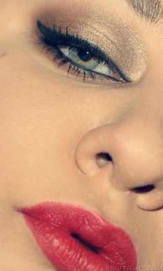 Gorgeous red lips and gold eye makeup from beautygala.com. Get the look with long wear makeup from Duane Reade!