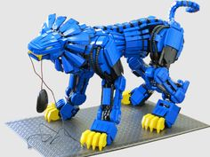 Geo, a 2 foot tall, 3 foot long robotic pet cat from the future. Built over the course of a year completely out of LEGOs.