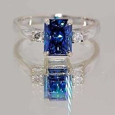 Platinum ring with emerald-cut blue