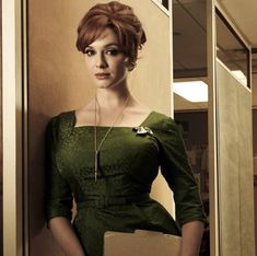 Joan Harris (Christina Hendricks) on Mad Men is the definition of sexy. We adore those form fitting 60's dresses!