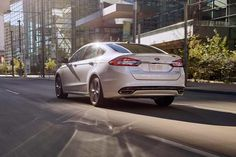 The 2018 Ford Fusion Titanium with integrated chrome exhaust tips.