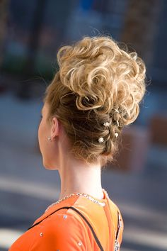 loose curl blond bun wig with pretty braid in the back for an extra flair