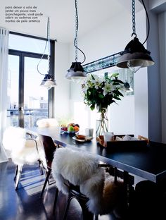 Cozy chairs, lamps and flowers.