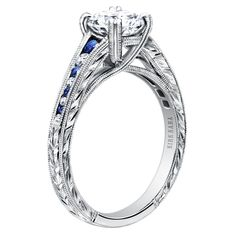 Kirk Kara Sapphire Engagement ring from the Stella collection style K1140BDC-R| hand engraved engagement ring | detailed engagement ring | round cut engagement ring |  artful engagement ring | romantic and vintage engagement ring | beautiful engagement ring