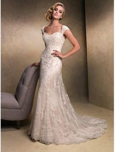 Stunning. A sweetheart neckline is my guilty pleasure when it comes to dresses. The straps are also pretty great. My kind of wedding dress. Simple yet elegant.