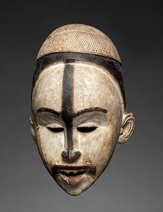 Mask  19th - early 20th century Geography: Democratic Republic of the Congo; Republic of the Congo; Cabinda, Angola Culture: Kongo peoples; Yombe group Medium: Wood, pigment Dimensions: H. 11 13/16 in. (30 cm), W. 6 3/4 (17.1 cm), D. 5 1/2 in. (14 cm)