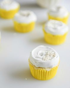 Fluffy Lemon Cupcakes with Whipped Coconut Cream I howsweeteats.com