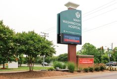 Hospital Entrance Pylon and Monument Sign with Dynamic LED Display. Design by Mitchell Associates.